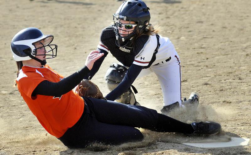 APPLYING THE TAG: Winslow High School catcher Gabby Languet tags Gardiner Area High School's Bri Brochu on Monday in Gardiner.