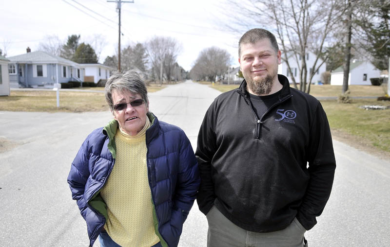 Penny Rafuse, left, Glenn Parkhurst and other residents of Violette Avenue in Waterville, where Ayla Reynolds lived, continue to keep the little girl in their thoughts. Ayla, whose third birthday would be Thursday, was reported missing in Dec. 2011.