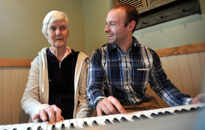 Scott McManaman, director at Bedside Manor, plays a duet of