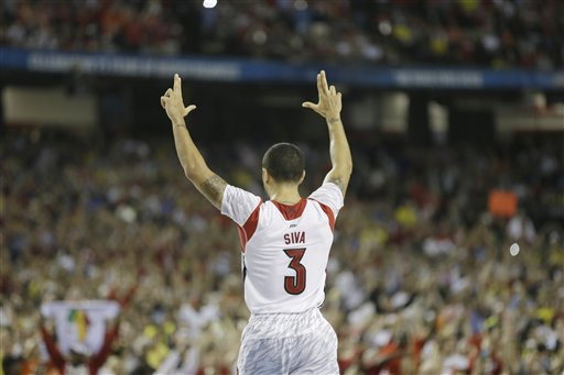 Louisville's Peyton Siva (3) gestures during the second half of the NCAA Final Four tournament college basketball championship game against Michigan Monday, April 8, 2013, in Atlanta. Louisville won 82-76. (AP Photo/Charlie Neibergall)
