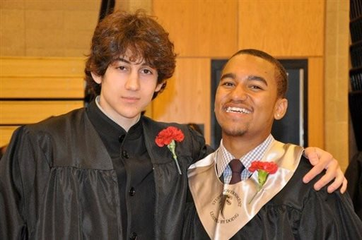 In this undated photo provided by Here & Now radio host Robin Young, Dzhokhar A. Tsarnaev, left, and Young's nephew, right, pose for a photo after graduating from Cambridge Rindge and Latin High School.