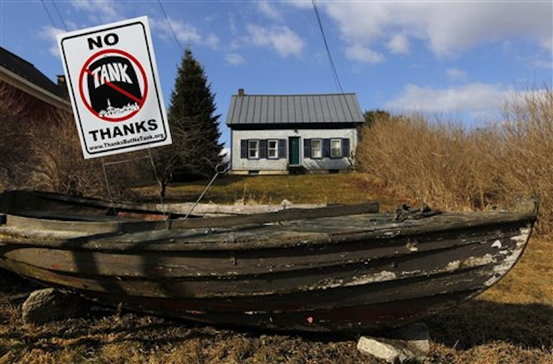 In this Friday, March 9, 2012 photo, a sign in opposition to a proposed 23-million gallon propane tank is seen in the front yard of a home in Searsport, Maine. (AP Photo/Robert F. Bukaty)