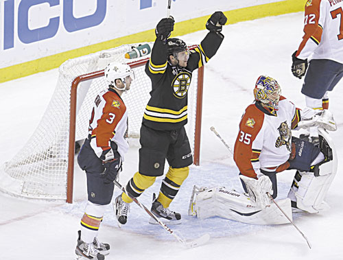 IT'S GOOD: Boston's Daniel Paille, center, celebrates a goal by teammate Dougie Hamilton (not shown) as Florida defenseman T.J. Brennan (3) and goalie Jacob Markstrom (35) look on in the second period Sunday at the TD Garden in Boston.