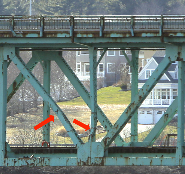 Red arrows point to two of bent supports that run between the lower railroad deck and the upper roadway deck of the Sarah Mildred Long Bridge. The supports were damaged when the tanker Harbour Feature hit the bridge on Monday.
