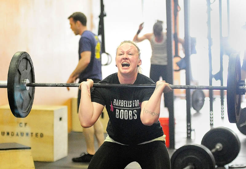 """HARD WORK: Ali McLaughlin, of Winslow, does a squat clean while performing the """"Klepto"""" Hero WOD on Saturday at CrossFit Undaunted in Augusta. The workout is named after Major David """"Klepto"""" Brodeur, a fighter piolot killed in Afghanistan."""