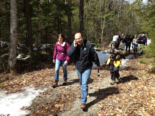 Journalists and neighbors leave the area leading to Christopher Knight's camp.