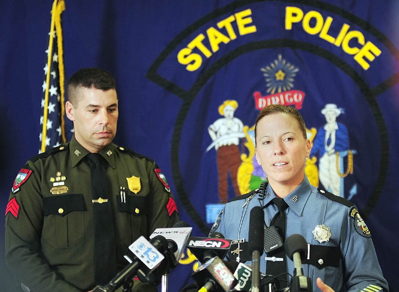 Warden Service Sgt. Terry Hughes, left, and State Police Trooper Diane Perkins-Vance talk about capturing Christopher Knight during a news conference on Wednesdayin Augusta.