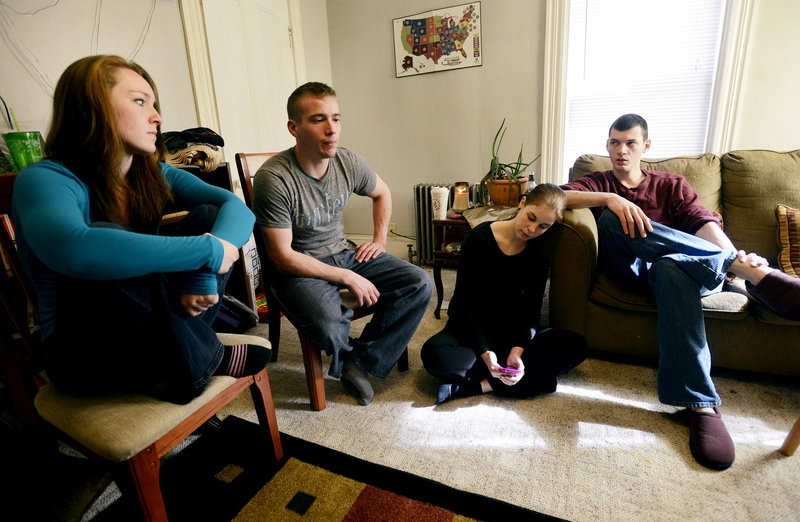 Aunts and uncles of Kitty McGuire talk about their 13-year-old niece, who took her life last month in Troy. From left, Bobbi Pelletier and Michael McGuire join Hannah and Timothy McGuire at the couple's home in Bangor. They hope that when police obtain access to Kitty's messages on her iPod, it may yield some answer to the mystery of what triggered her suicide.