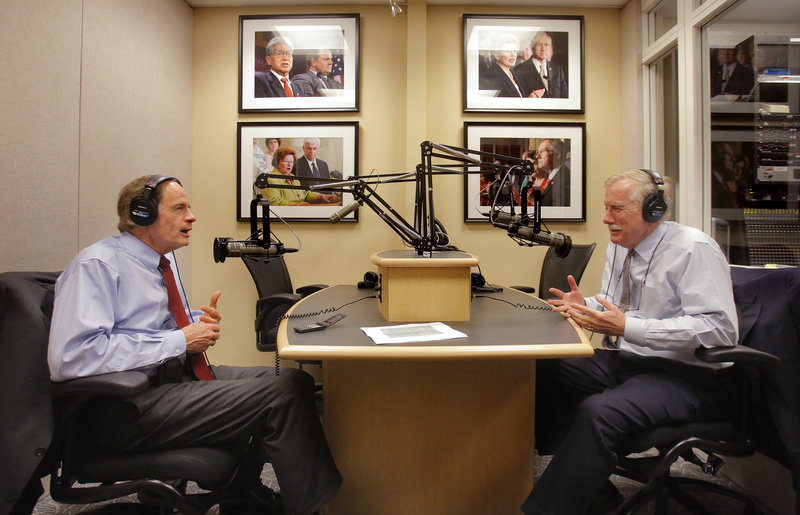 Joined by Sen. Tom Carper, D-Del., left, Sen. Angus King participates Thursday in a weekly radio program sponsored by WGAN radio. It was one of several media events that followed the Maine senator's already lengthy workday on the Senate floor.