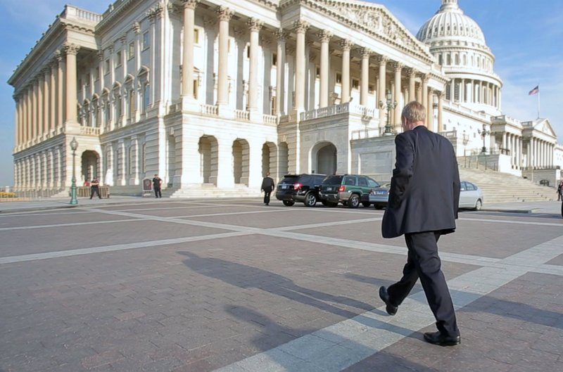Maine's independent senator arrives at the Capitol in Washington on Thursday. King lives about four blocks away and walks to work every morning.
