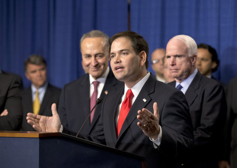 Sen. Marco Rubio, R-Fla., is flanked by Sen. Charles Schumer, D-N.Y., left, and Sen. John McCain, R-Ariz., as Rubio speaks about immigration reform legislation April 18.