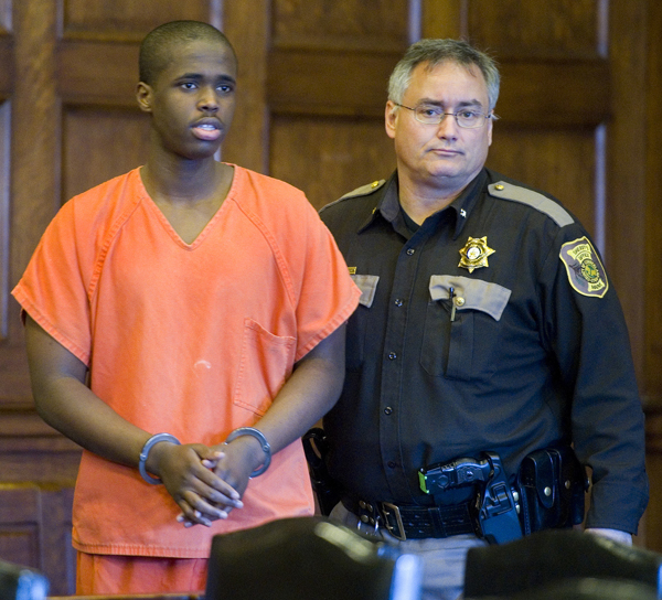 Mohammed Mukhtar arrives in court escorted by a Cumberland County sheriff's deputy.