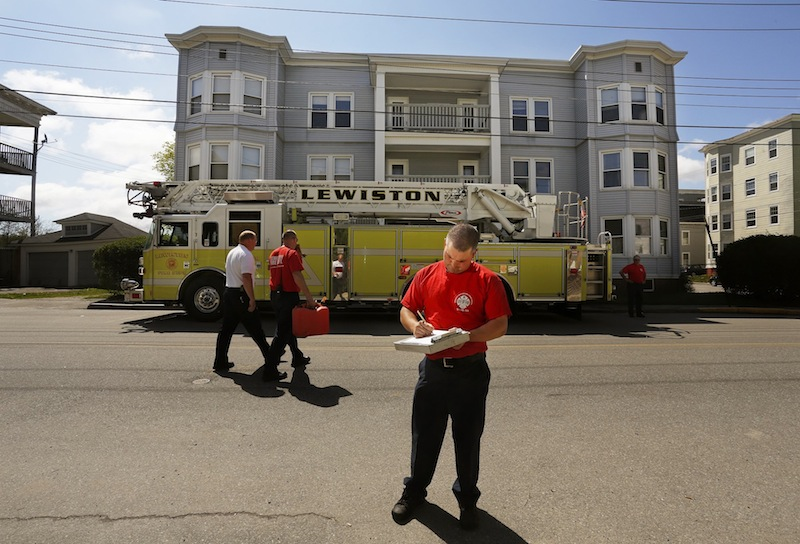 Lt. James Pelletier of the Lewiston Fire Dept. completes a vacant building inspection on Walnut Street Friday, May 10, 2013.