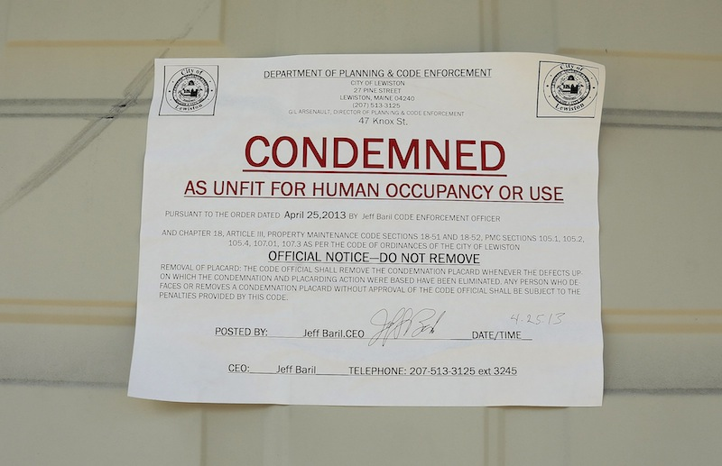 A sign marks a building condemned at 47 Knox Street in Lewiston Friday, May 10, 2013.