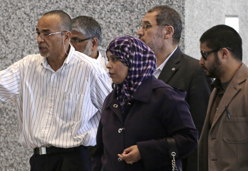 Family and supporters of 18-year-old Abdella Ahmad Tounisi, including his father, Ahmad Tounisi, left, leave federal court Thursday in Chicago.