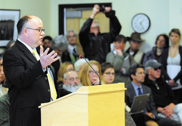 Rep. Lance Harvell (R-Farmington) introduces L.D. 718, An Act to Protect Maine Food Consumers' Right to Know About Genetically Engineered Food and Seed Stock, in a crowded hearing room before the Joint Standing Committee on Agriculture, Conservation and Forestry recently in the Cross State Office Building in Augusta. There were several other overflow rooms where spectators could listen in.