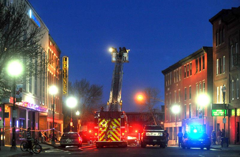 Firefighters battle a blaze in downtown Waterville Friday.