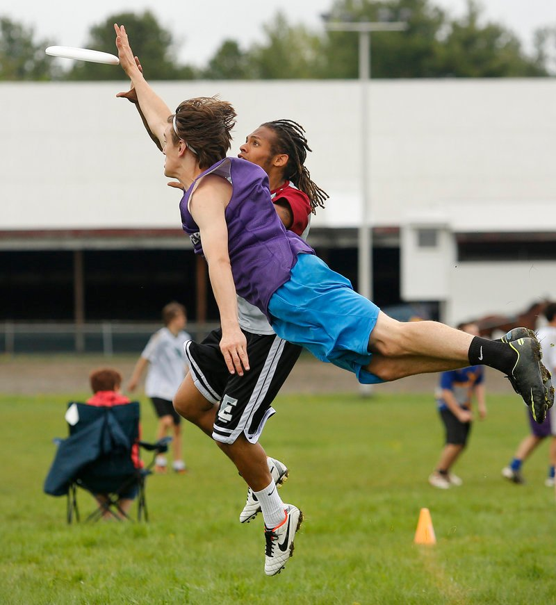 During an ultimate Frisbee tournament at Cumberland fairgrounds, Rocco Linehan of Hanover High School dives to knock away the disc from Jalen Diffin of Phillips Exeter Academy on Sunday, May 12, 2013.