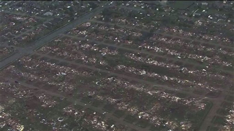 This photo provided by KFOR-TV shows homes flattened outside Moore, Okla., Monday, May 20, 2013. A monstrous tornado as much as a mile wide roared through the Oklahoma City suburbs Monday, flattening entire neighborhoods, setting buildings on fire and landing a direct blow on an elementary school. (AP Photo/KFOR-TV) MANDATORY CREDIT