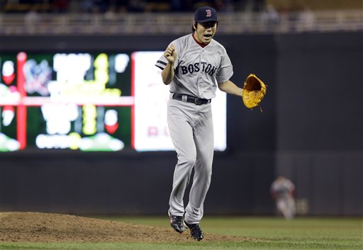 Boston Red Sox pitcher Koji Uehara of Japan celebrates the final out as the Red Sox beat the Minnesota Twins 3-2 in 10 innings of a baseball game, Friday, May 17, 2013, in Minneapolis. Uehara picked up the save. (AP Photo/Jim Mone)
