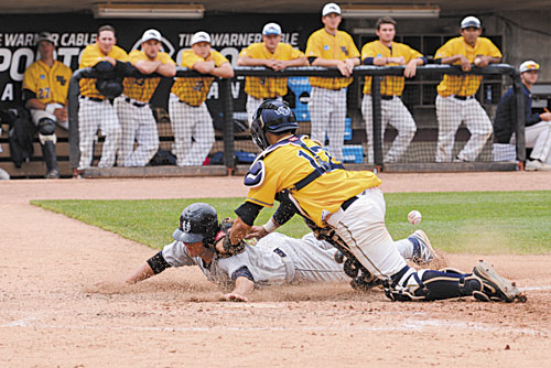 SAFE: University of Southern Maine's Forrest Chadwick, a Gardiner graduate, scores on teammate Chris Bernard's single in the eighth inning against Webster University in the Division III Baseball World Series on Sunday at Time Warner Cable Field in Appleton, Wis. The run gave the Huskies a 6-2 lead.