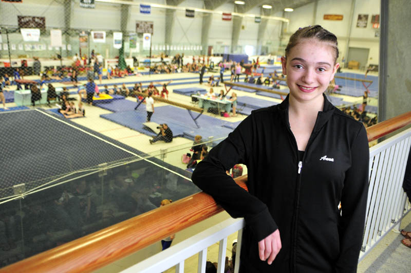DOING WHAT SHE LOVES: Anna Curtis had surgery on Oct. 2 to correct an abnormal curvature of her spine. She was told she would not be able to compete in gymnastics, but proved her doctors wrong. Last weekend, she won an all-around New England title.