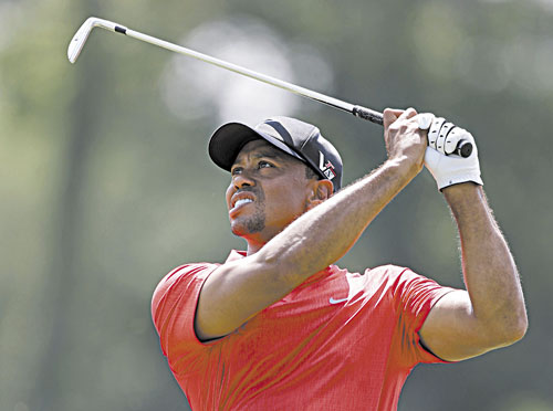 SWINGING TO VICTORY: Tiger Woods hits from the fifth fairway during the final round of The Players Championship on Sunday at TPC Sawgrass in Ponte Vedra Beach, Fla. Woods won the tournament by two strokes.
