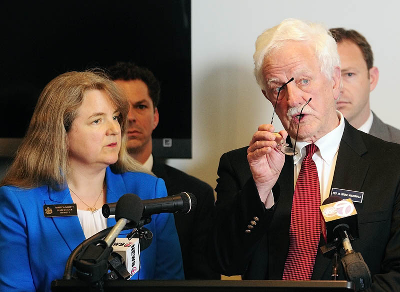 The co-chairs of the Legislature's Education Committee - Sen. Rebecca Millett, D-Cape Elizabeth, left, and Rep. Bruce MacDonald, D-Boothbay introduce a Democratic plan to grade schools during a news conference on Wednesday at the State House.