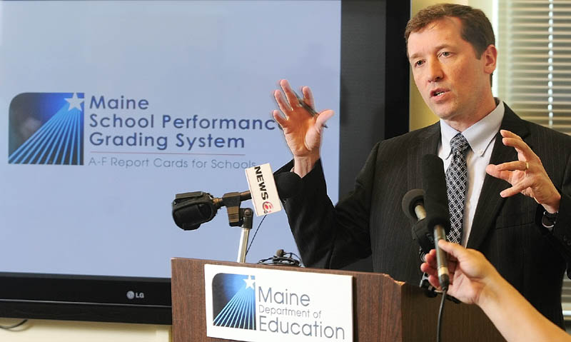 Education Commissioner Stephen Bowen announces a plan to help schools that were given failing grades by the LePage administration, at a news conference Wednesday in the Cross Building in Augusta.