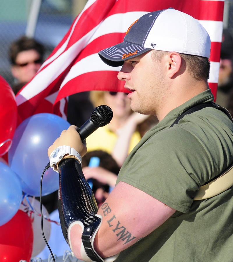 Staff Sgt. Travis Mills talks to the crowd before the start of the second annual Miles For Mills 5k on Monday at Cony High School in Augusta.