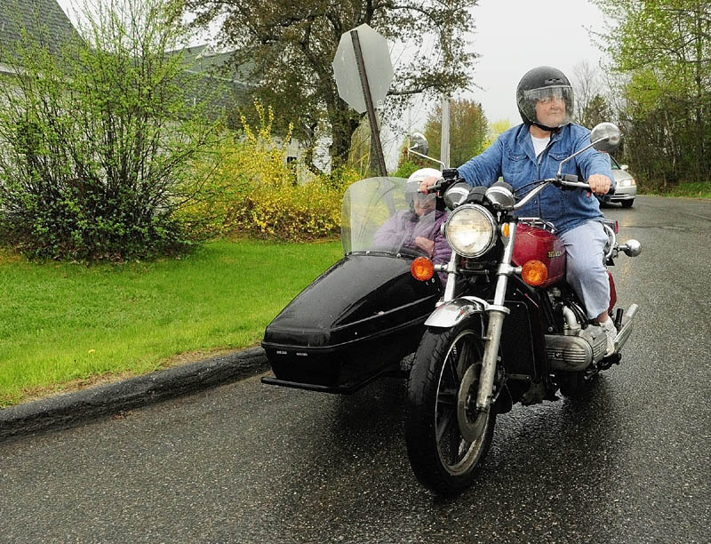 Donna McGibney rides her Honda GoldWing with her mother Charlotte McGibney on Friday in Readfield.