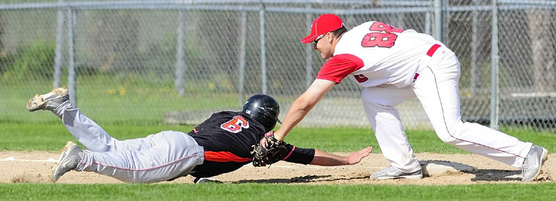 Skowhegan baserunner Kaleb Brown can't beat the pickoff throw back to first in time and gets tagged out by Cony first baseman Benjamin Lucas during a game on Friday May, 10 2013 in Augusta.