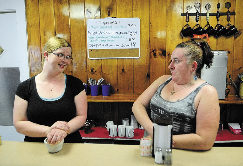 Employees Tricia Healey, left, and Jonica Palmer talk about how construction has negatively affected their lunch time crowds at Windsor Diner on Thursday in Windsor.