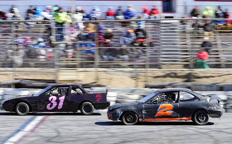 Leandra Martin, left, and Jason Stanley compete in the Thunder Four class feature race on the first day of the 2013 racing season on Saturday April 6, 2013 at Wiscasset Speedway.