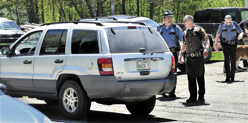 Police from several agencies converged at a residence on the Middle Road in Skowhegan after Ernest Almeida, 31, of Fairfield abandoned his vehicle, foreground, following a police chase where speeds exceeded 100 mph on Wednesday.