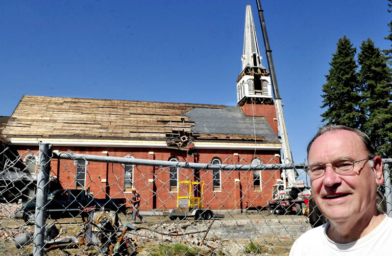 Local historian Bob Chenard on Tuesday, waits with others for workers to remove the steeple from the St. Francis de Sales Catholic Church in Waterville.