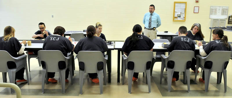Somerset County Jail Assistant Administrator Maj. Cory Swope speaks with female inmates at the East Madison jail on Tuesday. Somerset County officials filed a civil action case against the state Board of Corrections for $280,000 in funds the state has withheld in an ongoing dispute with the county.