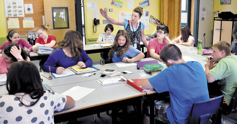 Phillips Elementary School language arts teacher Nicole Levesque works with students on Wednesday. The school recently received an A grade by the Maine Department of Education.