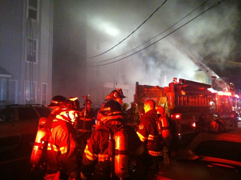 Firefighters battle a multi-structure blaze in downtown Lewiston in the early hours of Saturday morning.