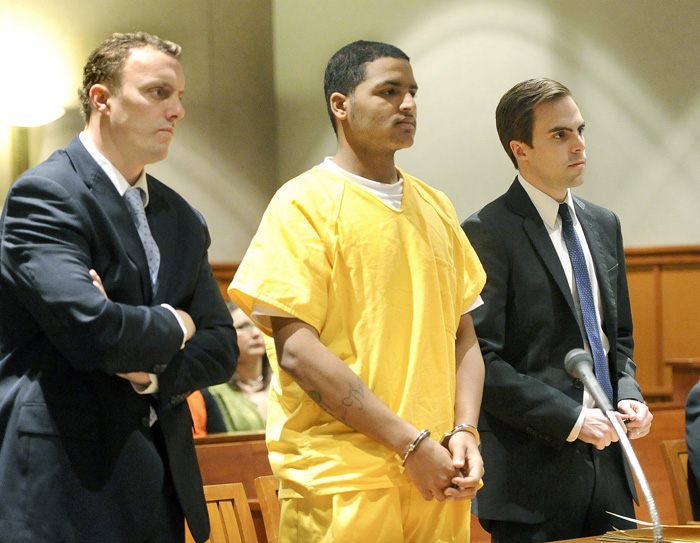 In this April 26, 2013 file photo, Anthony Pratt Jr. is flanked by attorneys Peter Cyr and Dylan Boyd. Pratt, 19, of Far Rockaway, N.Y. is accused of murdering Margarita Fisenko Scott last January in Portland.