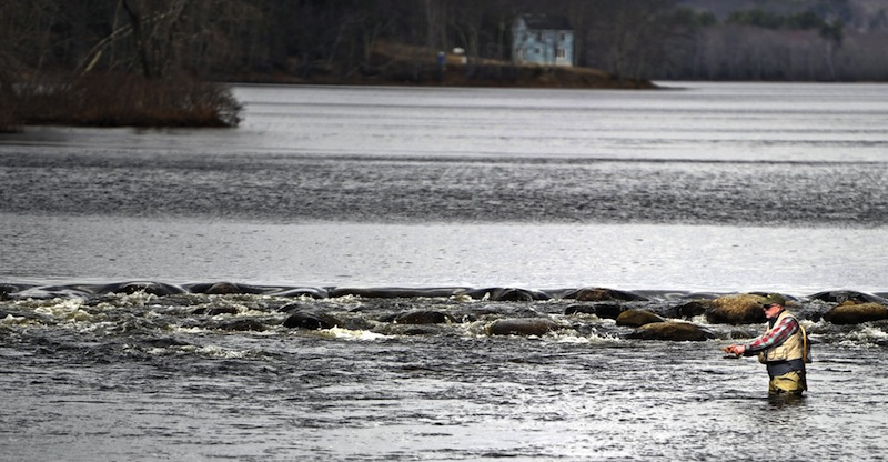 In this April 2012 file photo, Mike Gundel of Rockland fishes the St. George's River in Appleton for trout. Volunteer anglers are being sought to survey remote ponds and lakes around Maine in search of brook trout.