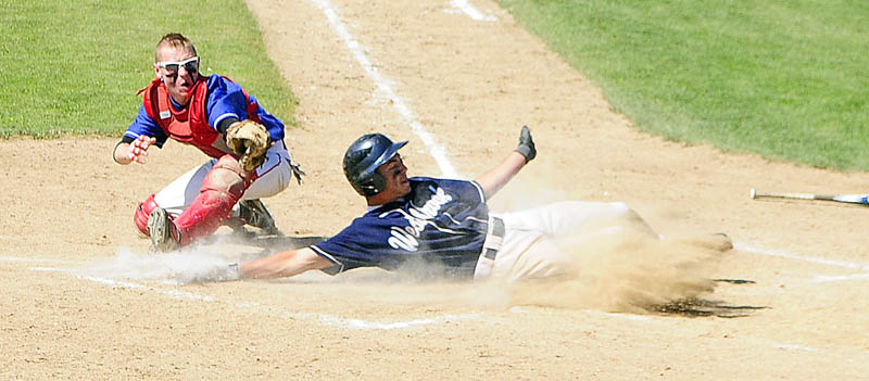 Westbrook's Kaleb Kent scores the Blue Blazes second run by beating throw to Messalonskee catcher Trevor Gettig during Class A baseball state championship game Saturday at Morton Field in Augusta.