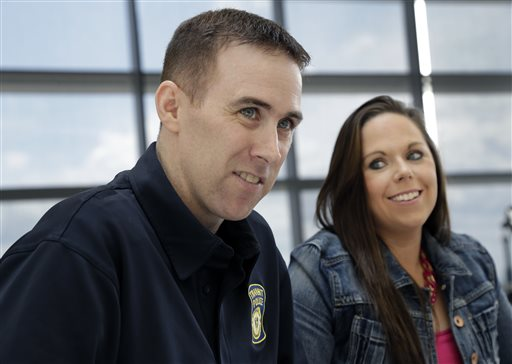 MBTA Police Officer Richard Donohue smiles with his wife, Kim, during an interview on May 19, 2013, at Spaulding Rehabilitation Hospital in Boston's Charlestown section. Donohue almost lost his life after being shot during the crossfire with the Boston Marathon bombing suspects in Watertown, Mass.