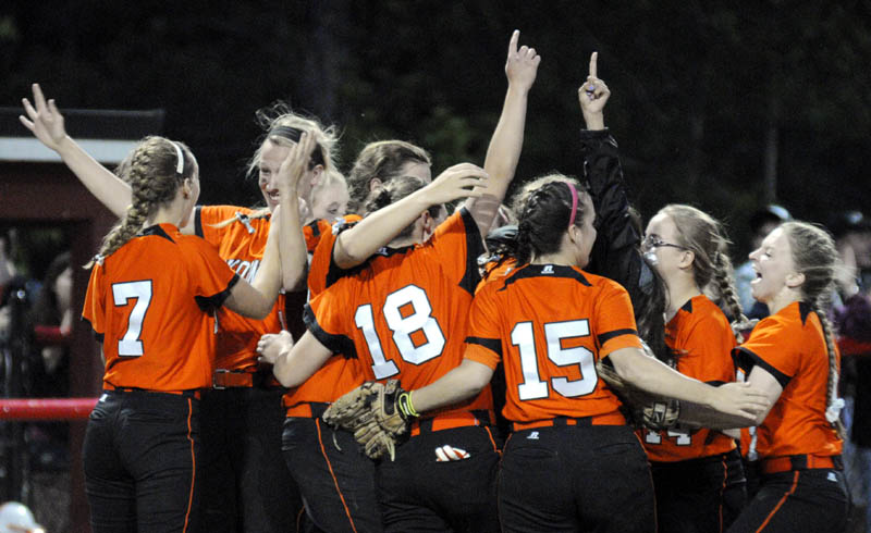 WE DID IT: The Skowhegan softball celebrates at the mound after winning the Eastern A title with a 2-0 win over Bangor on Thursday at Cony High School in Augusta.