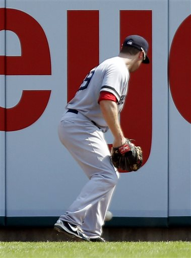 Boston Red Sox right fielder Daniel Nava chases a ball, that he dropped for an error, hit by Detroit Tigers' Avisail Garcia in the eighth inning on Sunday in Detroit. Red Sox manager John Farrell argued the call and was ejected from the game. The Tigers defeated the Red Sox 7-5.