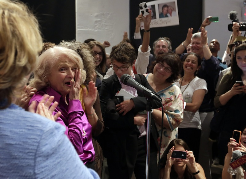 Edith Windsor, left, the plaintiff in the historic gay marriage case that was before the U.S. Supreme Court, wipes her eyes after addressing supporters at the LGBT Center, in New York, Wednesday, June 26, 2013. In a major victory for gay rights, the Supreme Court on Wednesday struck down a provision of a federal law denying federal benefits to married gay couples and cleared the way for the resumption of same-sex marriage in California. (AP Photo/Richard Drew)
