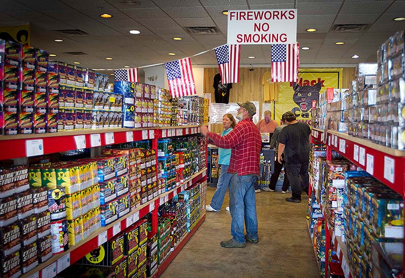 Fireworks fill the shelves at a Pyro City retail store in Winslow. Sales at Maine's fireworks stores have far surpassed initial projections when fireworks became legal last year for the first time in 63 years.