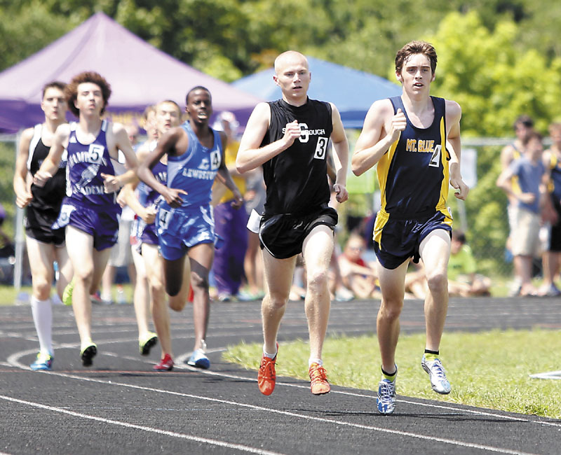 Justin Tracy of Mt. Blue High School leads a pack of runners before being passed by race winner Robert Hall of Scarborough High School during the boy's 1600 meter run at the Class A state championship meet Saturday in Brewer.