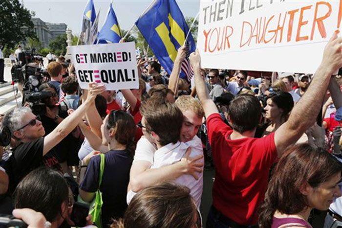 Supporters of gay marriage embrace outside the Supreme Court in Washington on Wednesday after the court cleared the way for same-sex marriage in California by holding that defenders of California's gay marriage ban did not have the right to appeal lower court rulings striking down the ban.