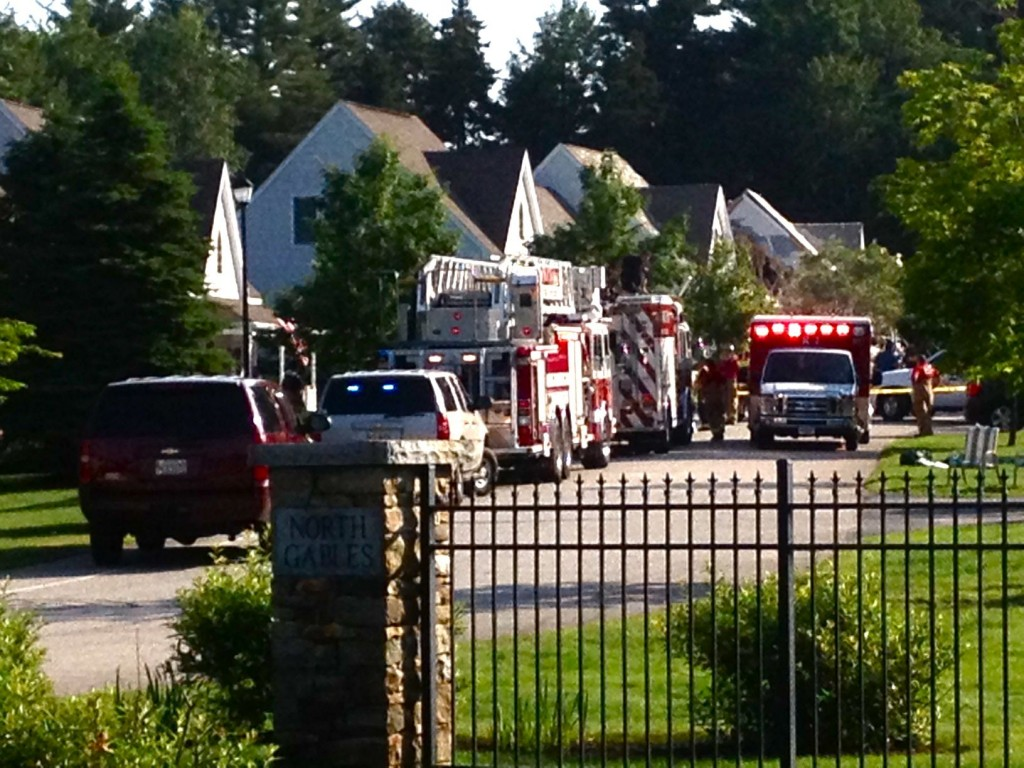 Emergency personnel from Yarmouth, Freeport and other towns respond to the scene of a gas explosion at North Gables condo complex in Yarmouth.